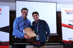 Adobe senior manager for strategic relations at Creative Cloud for Enterprise, Chetan Shah presenting a token of appreciation to Guru Vaidya